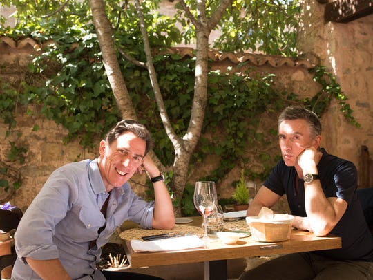 "Rob Brydon (left) and Steve Coogan enjoy culinary delights in ""The Trip to Spain."""