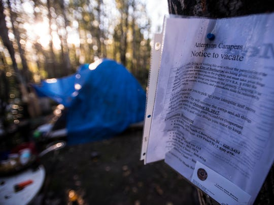 A trespass notice posted by the city warned that a camp off Sears Lane in Burlington would be cleared out on Tuesday, Oct. 10, 2017, but by 9 a.m. there were no signs of work at the site.
