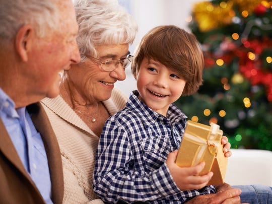 Cropped shot of a young boy with his grandparents on Christmas day