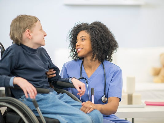 Nurse Talking to a Disabled Child