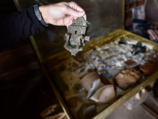 Jessica Crawford holds an original iron lock found