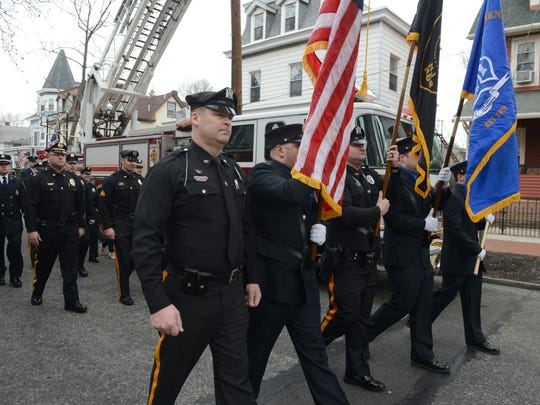 Gloucester City Police officers parade down Monmouth Street to St. Mary's Church during Gloucester City's first responders appreciation day on Saturday.