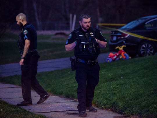 Police stand guard outside of 10/12 Southview Drive in South Burlington Thursday night, May 3, 2018, after a woman was found shot dead inside. Police are searching for Leroy A. Headley in connection with the woman's death.