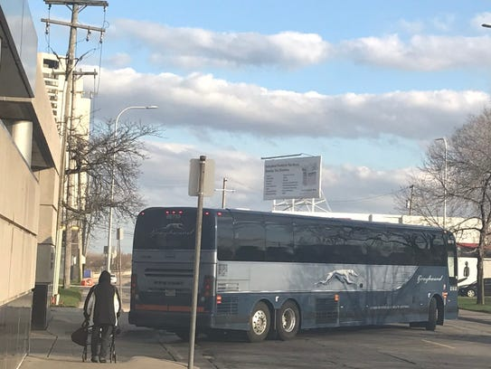 A Greyhound bus pulls out of the Detroit bus terminal