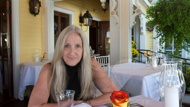 Sondra Beninati, owner of The Gables Inn & Restaurant in Beach Haven, sits in the outside dining area.