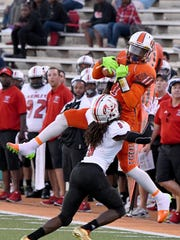 Mansfield Senior's Jornell Manns, a Minnesota commit, makes a leaping catch last season against Canton McKinley.