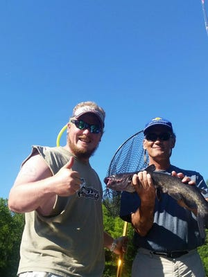 Jarrid Houston and company with a decent catfish caught in northwest Wisconsin.
