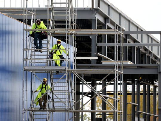 Contractors use a temporary stairwell to depart from