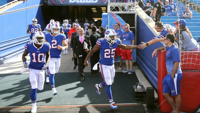 Buffalo running back LeSean McCoy is greeted by fans as he and the Bills come onto the field to warm up before its game against Tampa Bay.