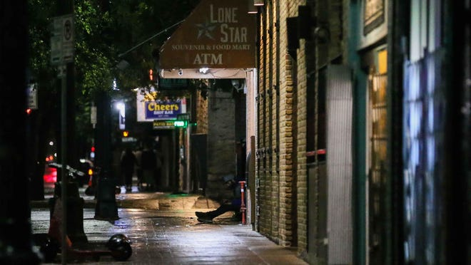 A view of Austin's 6th Street on March 21 shortly after city and county elected officials opted to close down bars, restaurants and dining rooms due to the coronavirus pandemic.