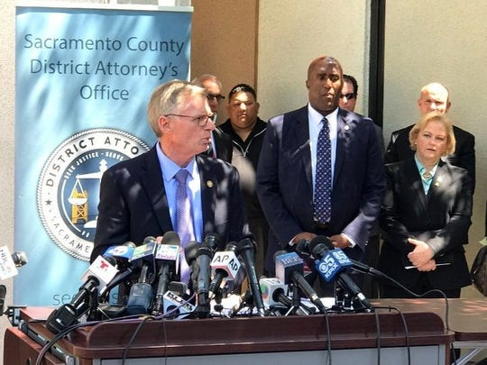 Ventura County District Attorney Greg Totten, at podium, participates in a news conference Wednesday in Sacramento announcing the arrest of the suspected Golden State Killer.