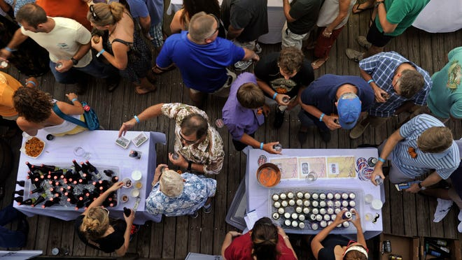 Visitors sample craft beers Saturday during the second annual Craft Beer Festival at The Fish House in downtown Pensacola.