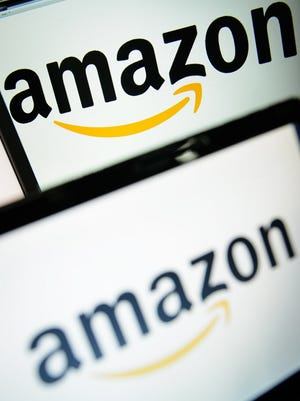 This December 11, 2014 file photo shows  the logo of the online retailer Amazon displayed on computer screens in London.