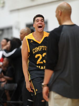 Timmy Allen of the Compton Magic yells towards LaVar Ball after a dunk.
