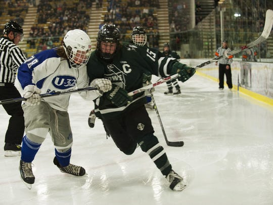Chad Haggerty (15) and Stowe will aim for a third straight crown against rival U-32 in Thursday's Division II high school boys hockey state championship game.