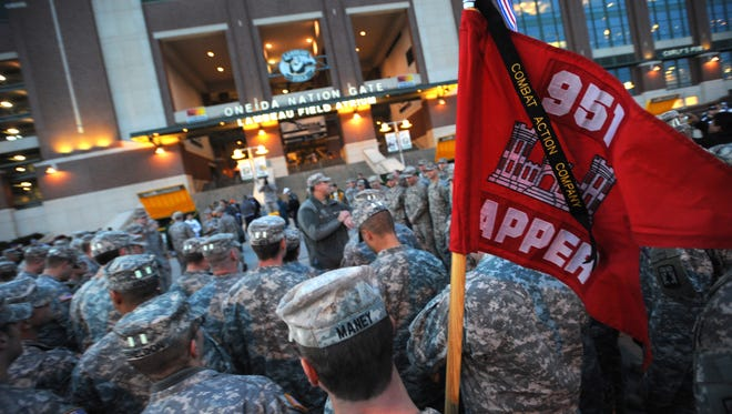 National Guard soldiers gather outside Lambeau Field before a Green Bay Packers game at Lambeau Field in November 2010.