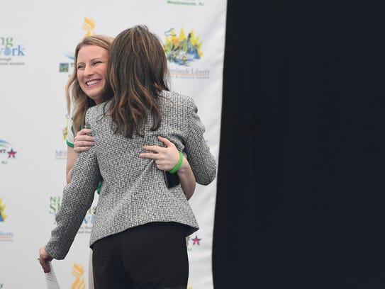 Elizabeth Stamler of Scotch Plains gets a hug during