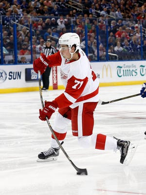 Oct 13, 2016; Tampa, FL, USA; Red Wings center Dylan Larkin shoots against the Tampa Bay Lightning.