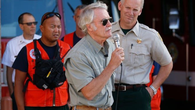 Gov. John Kitzhaber speaks after a briefing on the status of the Rowena fire, burning west of The Dalles, Ore. on Friday morning, Aug. 8, 2014.