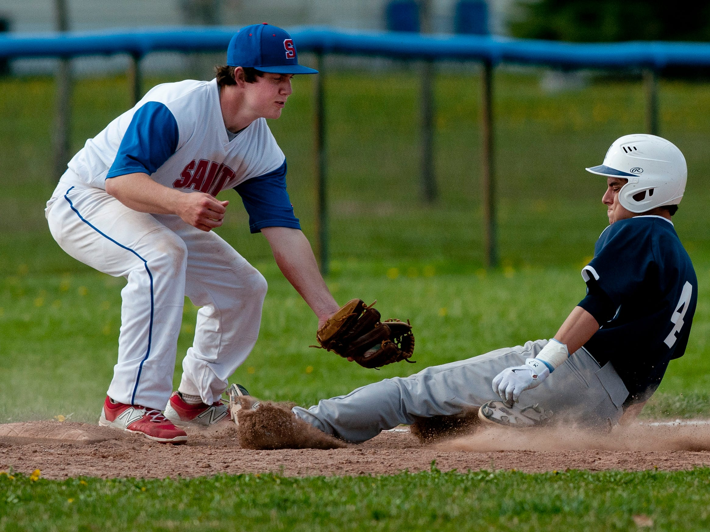 St. Clair's Jared Ambrose tags out Marysville's Joe Koch at third during a baseball game Wednesday, May 6, 2015 at St. Clair High School.