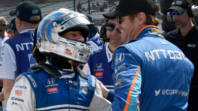 Chip Ganassi Racing IndyCar driver Tony Kanaan (10) talks to teammate Scott Dixon,right, following his qualifying run for the Indianapolis 500 Friday, May 20, 2017, afternoon at the Indianapolis Motor Speedway.