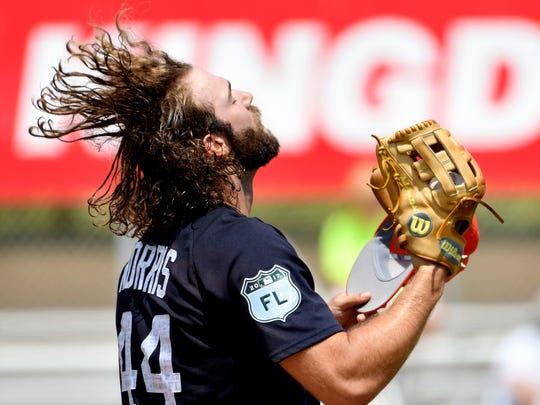Apr 1, 2017; Jupiter, FL, USA; Detroit Tigers starting pitcher Daniel Norris slings back his hair before taking the mound during a spring training game against the Miami Marlins at Roger Dean Stadium.