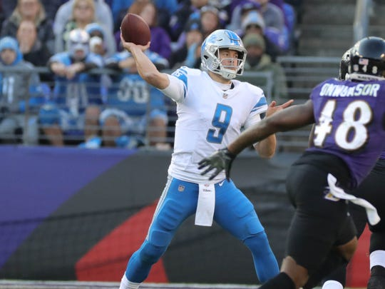 Matthew Stafford passes during the third quarter of