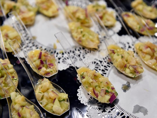 Samples of tilapia ceviche are offered at first-ever