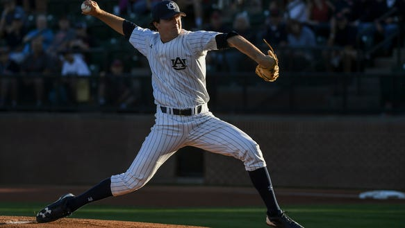 Auburn pitcher Casey Mize earned a complete game victory