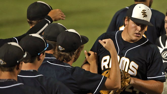 Southeast Polk pitcher Nick Arnold, far right, was mobbed by teammates as they celebrated a 1-0 win over Cedar Rapids Kennedy in Class 4-A quarterfinal at the 2014 State Baseball Tournament at Principal Park.