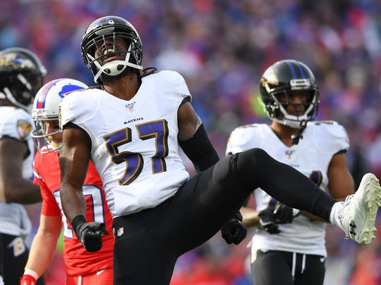 Baltimore Ravens middle linebacker Josh Bynes (57) reacts to his sack during the first quarter against the Buffalo Bills at New Era Field.