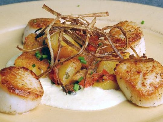 One of Brian Polcyn's recipes is Pan-seared Sea Scallops with Sweet Corn Sauce.