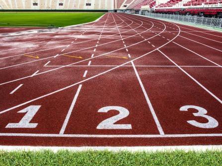 Red running track in The National Stadium of Thailand, Bangkok.