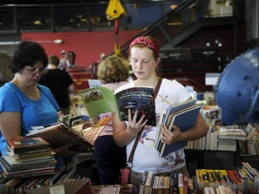 Rose Crosset, 17, right, and her mother Lisa Crosset, of Springettsbury Township, browse during the Book Blast at the Agricultural and Industrial Museum in 2012. (FILE PHOTO)