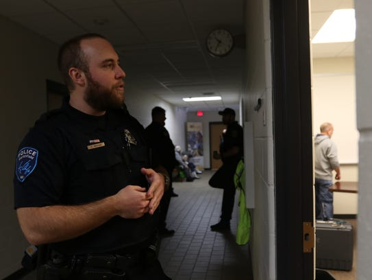 Wisconsin Rapids officer Alex Mitchell enters a room