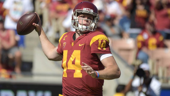 Oct 7, 2017; Los Angeles, CA, USA; Southern California Trojans quarterback Sam Darnold (14) throws a pass against the Oregon State Beavers during a NCAA football game at the Los Angeles Memorial Coliseum. Mandatory Credit: Kirby Lee-USA TODAY Sports