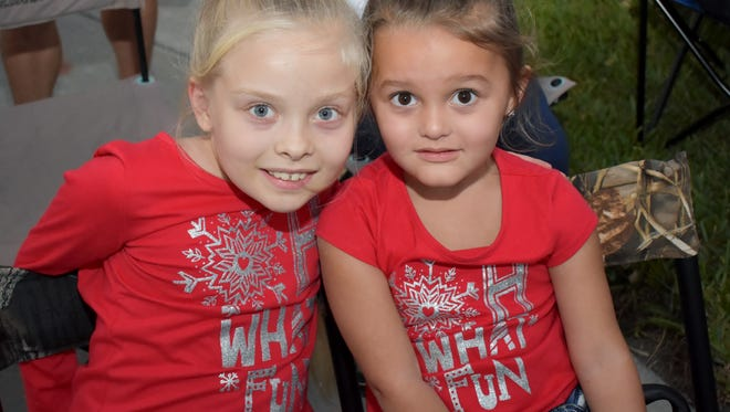 Makylei and Emmalyn Villeneuve were excited to see the floats and, of course, Santa Claus.