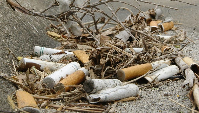 Discarded cigarette butts like these litter roads, parking lots and beaches.