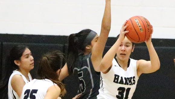 Jessica Magallanes, 31, of Hanks gets a rebound against