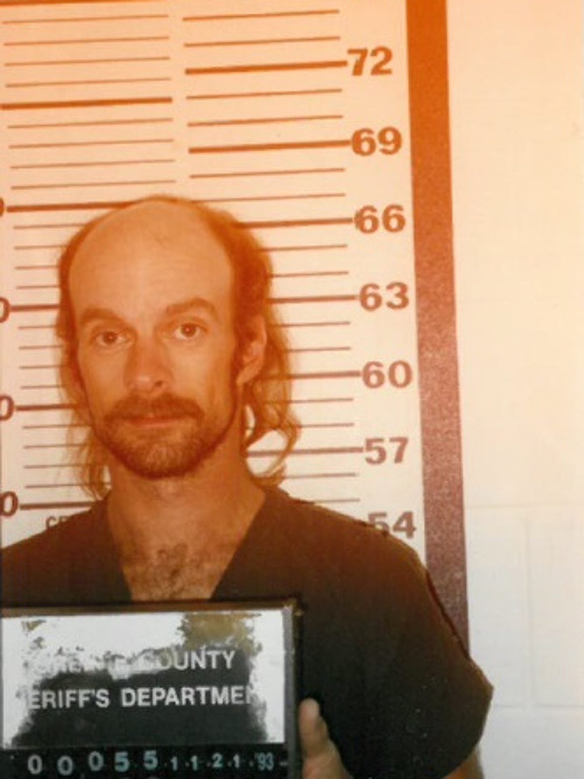 A 1993 booking photo of Gary Davis