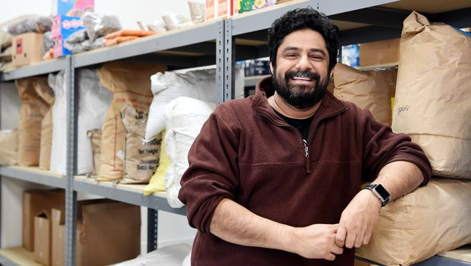 Meherwan Irani, owner of Chai Pani and Spicewalla, stands among his inventory of spices at his production facility at River Arts Makers Place in Asheville January 23, 2018.