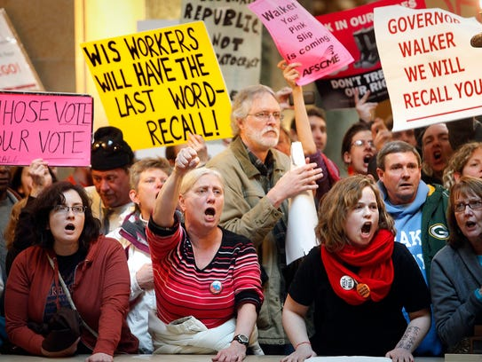 Demonstrators protest at the Wisconsin state Capitol