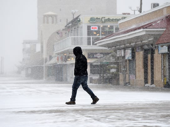 Snow falls in Rehoboth on Friday as a winter storm