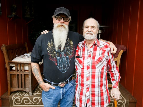 Brothers Karl Jensen, left, and Gary, right, stand