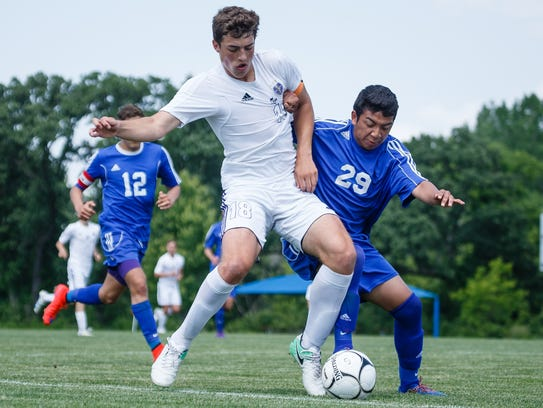 Norwalk's Jack Palen battles for possession with Perry's