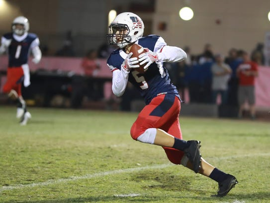 Tulare Western KeShon Butler runs in the open field