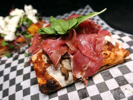 Prosciutto e funghi pizza at Piazza Romana.