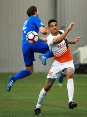 The Bucks' Jacob Bevan (right) steps in front of Dayton's Jacob Petrey during Wednesday's 2-0 PDL victory.