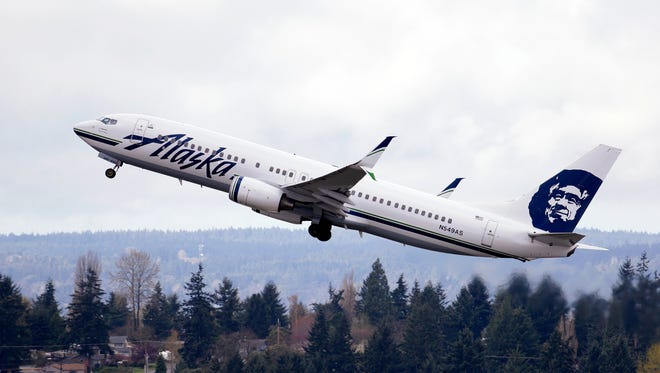 In this photo taken Tuesday, March 24, 2015, an Alaska Airlines jet takes off at Seattle-Tacoma International Airport. The airline announced new service to Nashville starting in September.