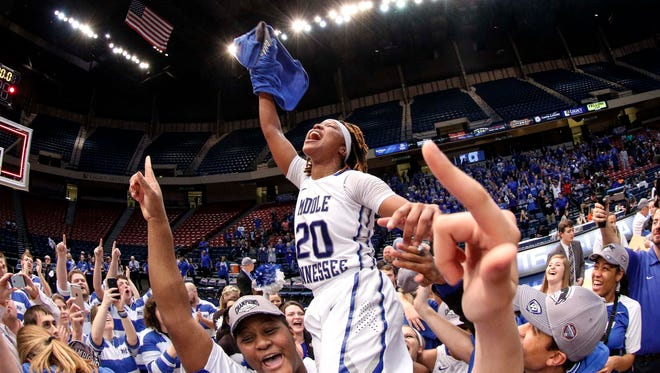 Mar 12, 2016; Birmingham, AL, USA; Middle Tennessee Lady Raiders congratulate teammate Middle Tennessee Lady Raiders guard Ty Petty (20) after winning the women's Conference USA basketball Championship 70-54 over Old Dominion Lady Monarchs at Legacy Arena. Mandatory Credit: Marvin Gentry-USA TODAY Sports